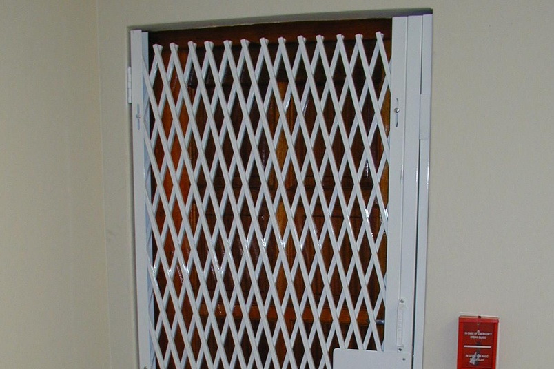 The double diamond trellis security door is very tightly woven to prevent access.