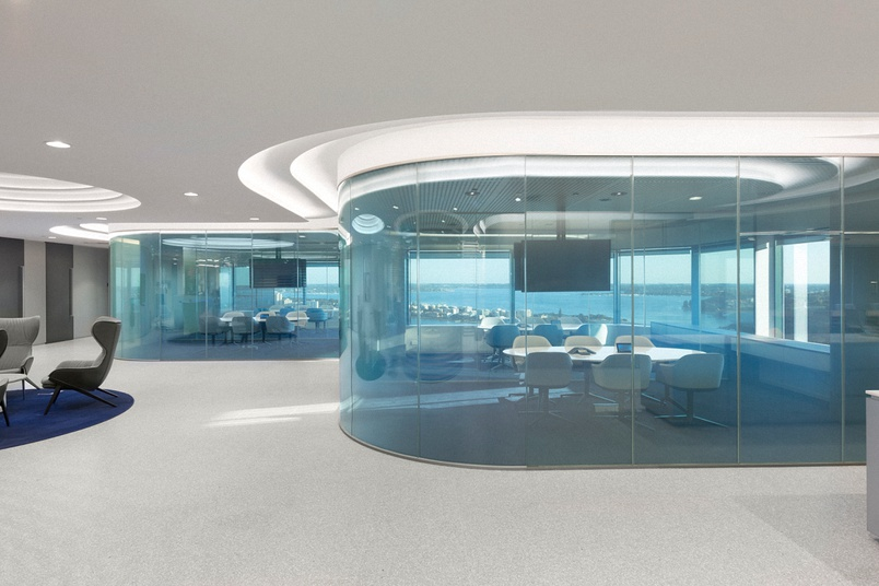 Clear custom-switchable laminated curved glass (vision mode) – office meeting room.