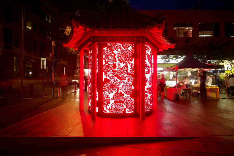 This public installation features backlit patterned curved glass panels.